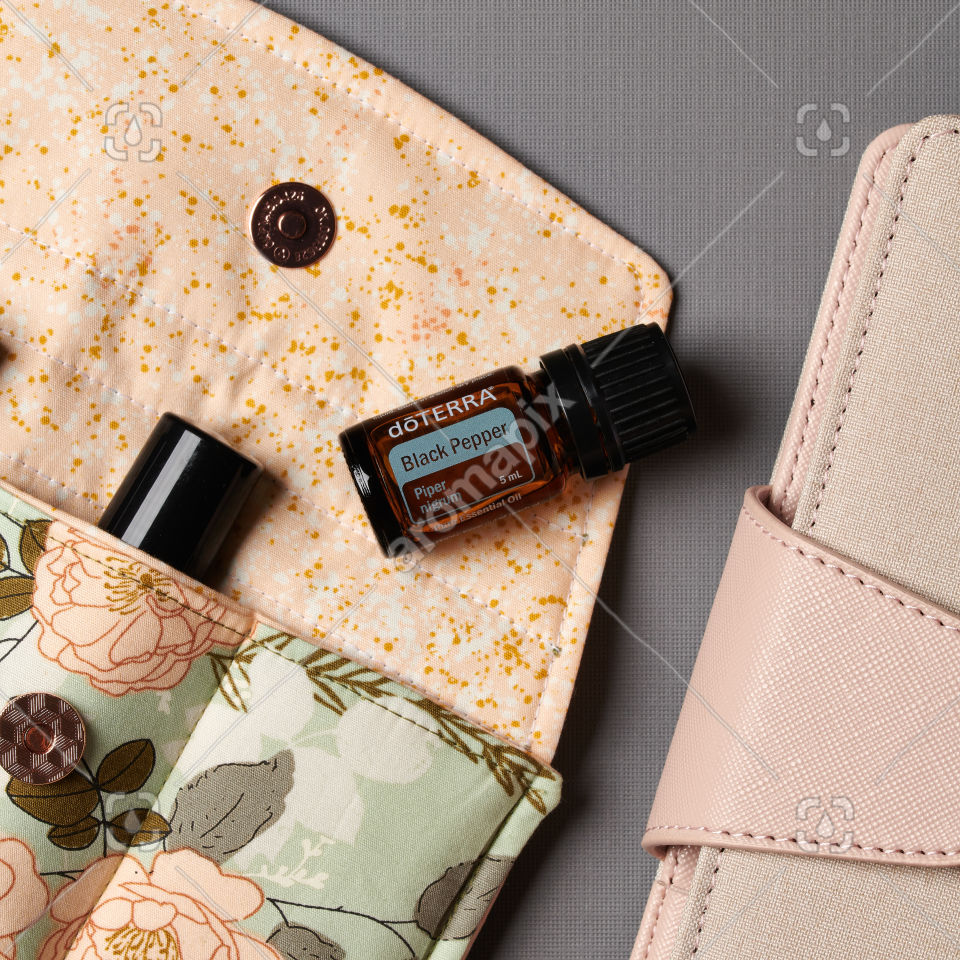 doTERRA Black Pepper and accessories on gray