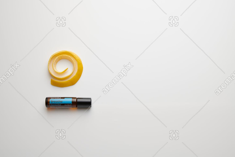 doTERRA Breathe Touch with lemon peel on white perspex