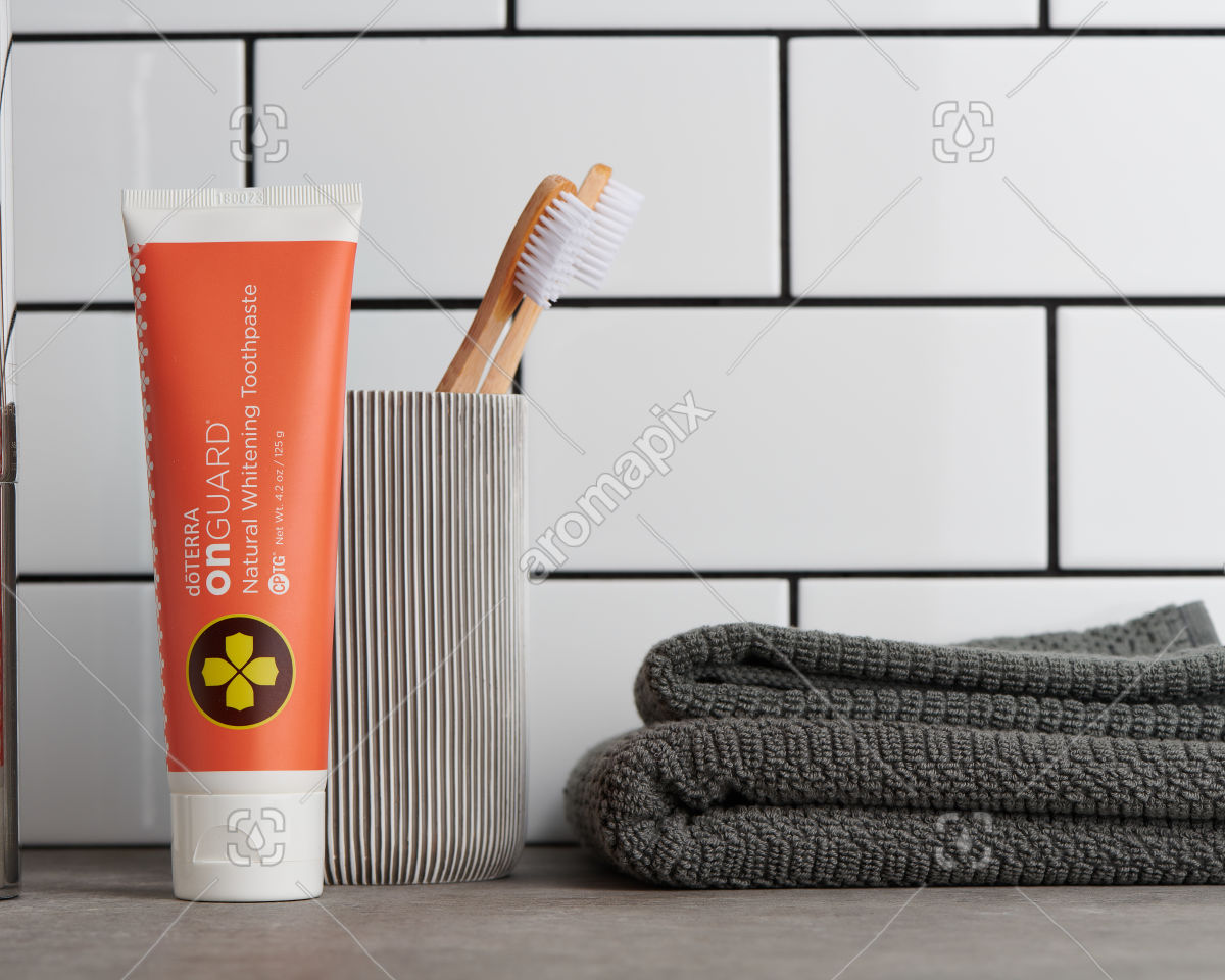 doTERRA On Guard Natural Whitening Toothpaste with bathroom accessories in bathroom
