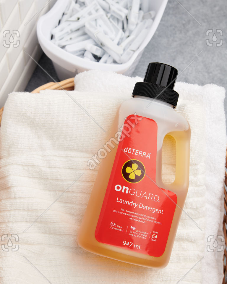 doTERRA On Guard Laundry Detergent in a basket of towels
