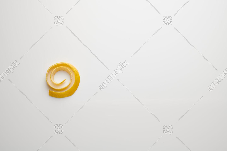 Lemon peel on white perspex
