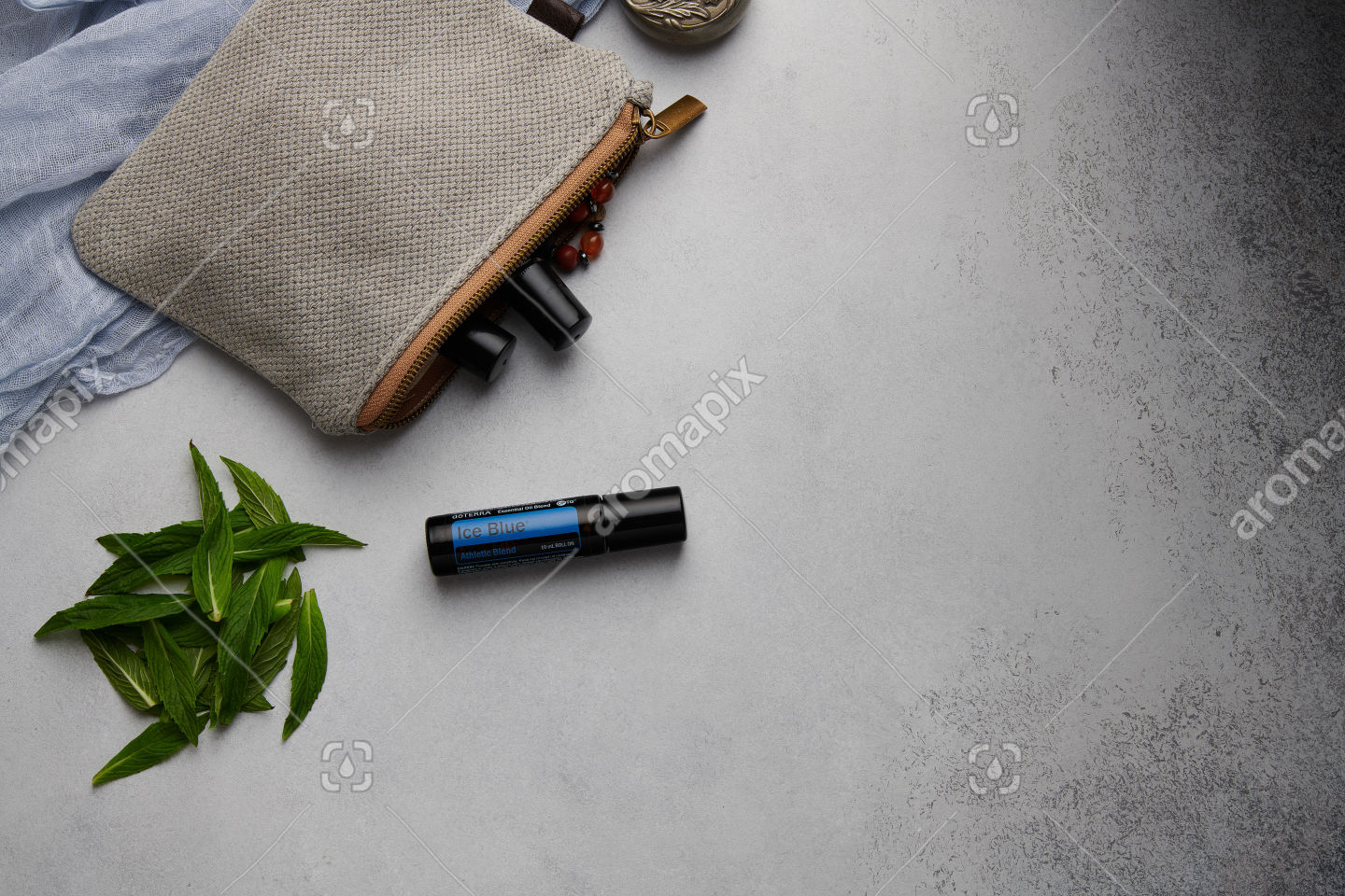 doTERRA Ice Blue Roll On with mint leaves on white