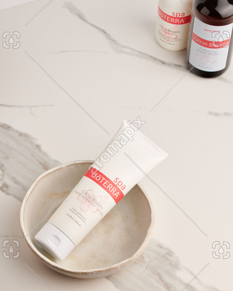 doTERRA Citrus Bloom Hand and Body Lotion in a ceramic bowl on white marble