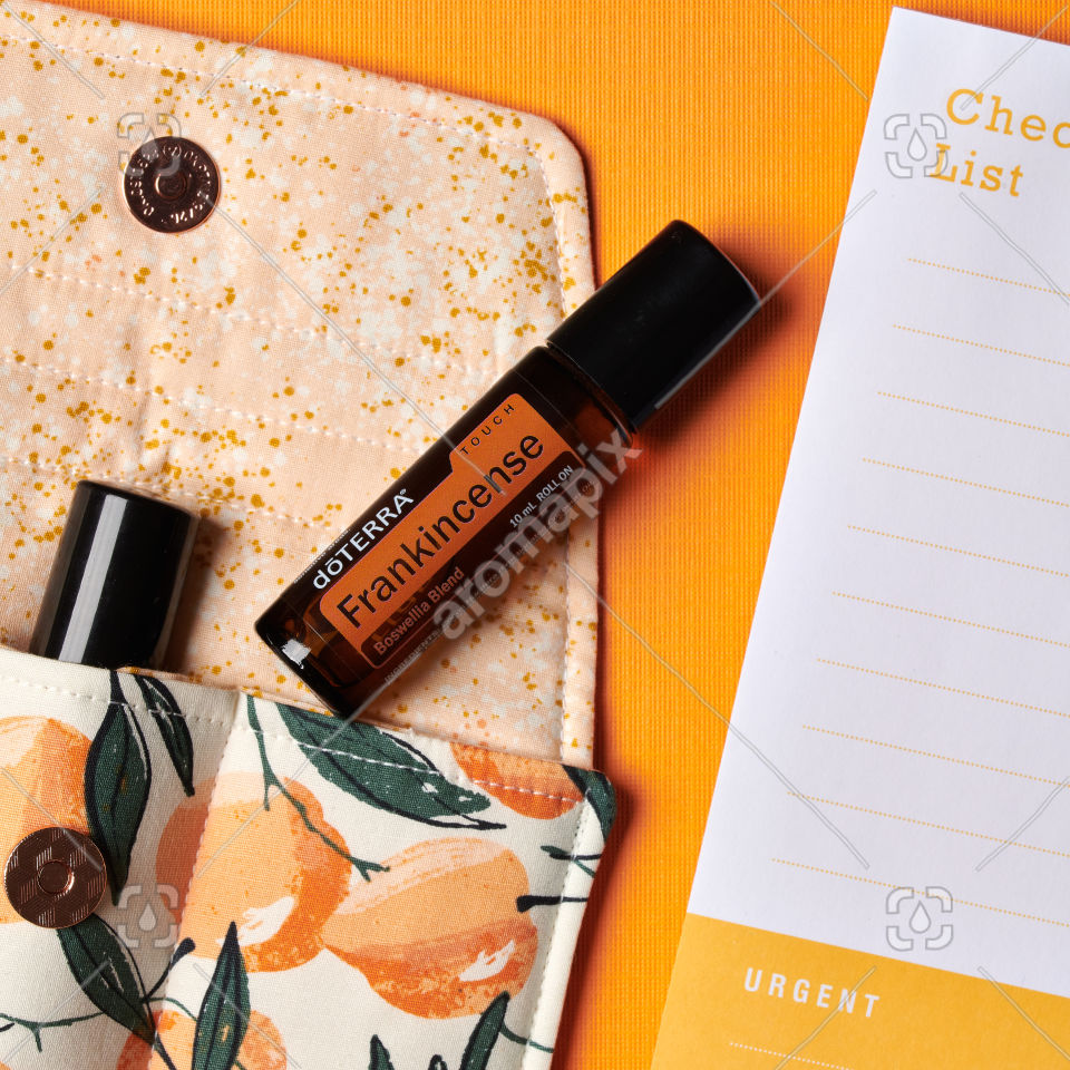 doTERRA Frankincense Touch with accessories on orange