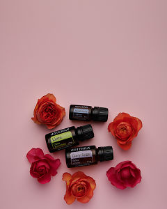 doTERRA Juniper Berry, Lime and Clary Sage with orange and red  roses on a pink card background.