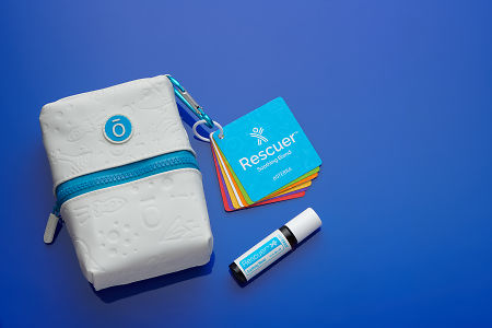 doTERRA Kids Oil Collection carry case, instructional flashcards and Rescuer 10ml Roll On on blue perspex.