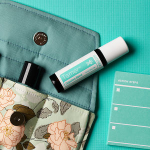 doTERRA Tamer on an essential oil bag and a check list on a  turquiose blue textured background.