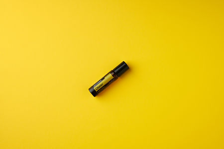 doTERRA Cheer Touch on a gold colored background.