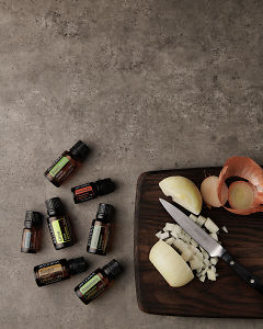doTERRA Gourmet Cooking Wellness Box with food ingredients on a kitchen bench with copy space to add your message.