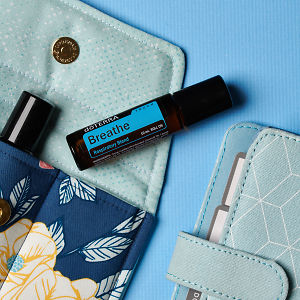 doTERRA Breathe Touch on an essential oil bag with a diary on a blue textured background.