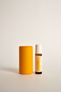 doTERRA Kids Oil Collection roll-on bottle Thinker next to a yellow wooden block.