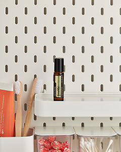 doTERRA Beautiful Touch on a bathroom shelf with additional doTERRA products and bathroom accessories.