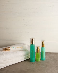doTERRA Verage Skin Care Collection with a white towel on a stone bathroom bench top.