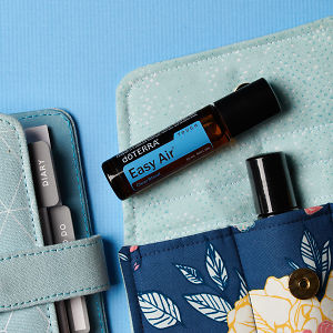 doTERRA Easy Air Touch on an essential oil bag with a diary on a blue textured background.