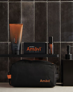doTERRA Amavi After Shave Lotion, Amavi Touch, Amavi Bath Bar and Amavi bag in a bathroom.