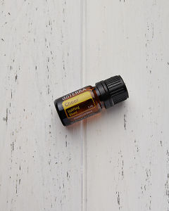 doTERRA Cheer on a white wooden background.