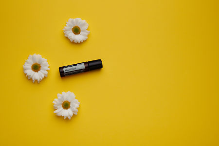 doTERRA Jasmine Touch with white flowers on a yellow card stock background.