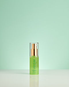 doTERRA Verage Hydrating Serum on a pale green background with reflection.