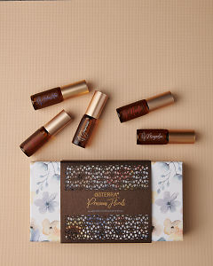 doTERRA Precious Florals Collection featuring Neroli Touch, Jasmine Touch, Rose Touch, Magnolia Touch and Blue Lotus Touch on a tan linen textured  background.