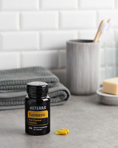 doTERRA Turmeric Capsules with bathroom acessories on a bathroom bench top.