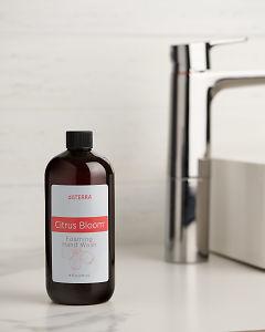 doTERRA Citrus Bloom Foaming Hand Wash on a bathroom vanity.