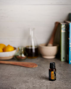 doTERRA Citrus Bliss with kitchen equipment on a gray stone kitchen bench.