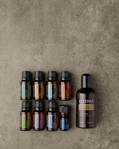 doTERRA AromaTouch Pro Enrolment Kit in portrait  format on a gray stone background.