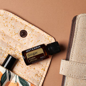 doTERRA Ginger on an essential oil bag with a diary on a brown textured background.