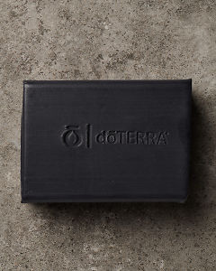 An opened doTERRA Onyx Balance Bath Bar on a bathroom bench.