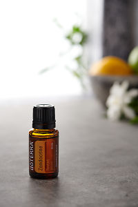 doTERRA Zendocrine on a bench in a rustic setting near a window.