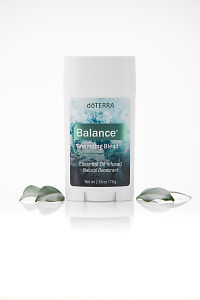 doTERRA Balance natural deoderant with leaves on a white background with reflection.