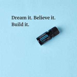 Dream it. Believe it. Build it – inspiration quote about doTERRA Blue Tansy printed on a pale blue background.
