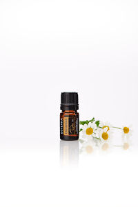 doTERRA Clementine with flowers on a white background with reflection.