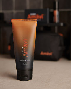 doTERRA Amavi After Shave Lotion on a bathroom bench.