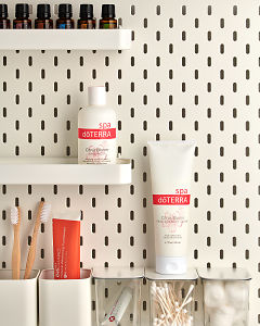 doTERRA Citrus Bloom Body Wash and Citrus Bloom Hand and Body Lotion onbathroom shelves with bathroom accessories and additional doTERRA products.