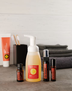 doTERRA On Guard essential oil blend, On Guard Sanitising Mist and On Guard Touch with a On Guard Foaming Hand Wash Dispenser on a bathroom bench.