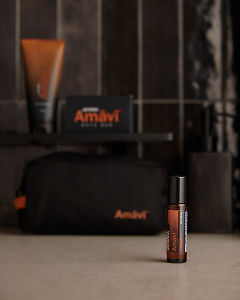 doTERRA Amavi Touch on a gray stone bathroom bench.