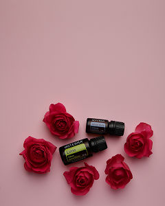 doTERRA Lime and Juniper Berry with red roses on a pink card background.