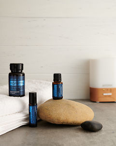 doTERRA Adaptiv, Adaptiv Capsules and Adaptiv Touch with a white towel and a Lumo diffusr on a benchtop.