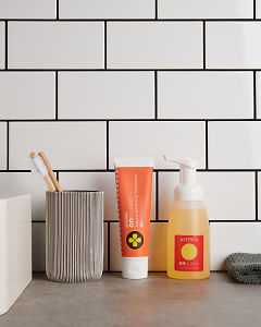 doTERRA On Guard Natural Whitening Toothpaste and On Guard Foaming Handwash on a bathroom vanity.
