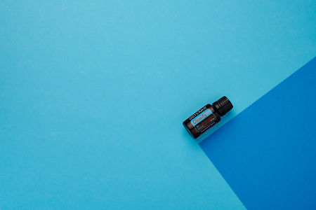 doTERRA Clearify on a dark blue and light blue geometric background.