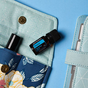 doTERRA Peace on an essential oil bag with a diary on a blue textured background.