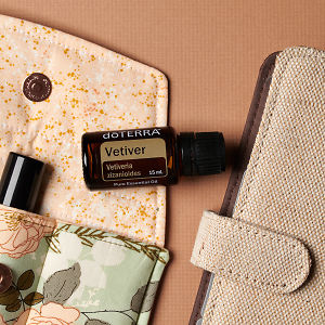 doTERRA Vetiver on an essential oil bag with a diary on a brown textured background.