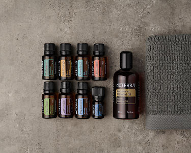 doTERRA AromaTouch Pro Enrolment Kit on a gray stone background.