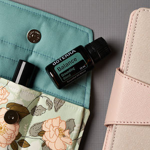 doTERRA Balance on a handmade essential oil bag with a diary on a gray textured background.