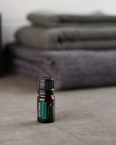 doTERRA Ravintsara on a gray stone bathroom bench.