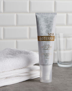 doTERRA Spa Hydrating Body Mist with Beautiful Blend with a white towel and tumbler on a stone bathroom bench top.