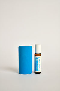 doTERRA Kids Oil Collection roll-on bottle Rescuer next to a blue wooden block.