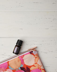 doTERRA Anchor and an essential oil bag on a white wooden background.