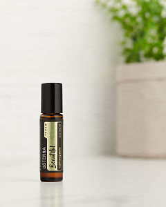 doTERRA Beautiful Touch on a white benchtop.